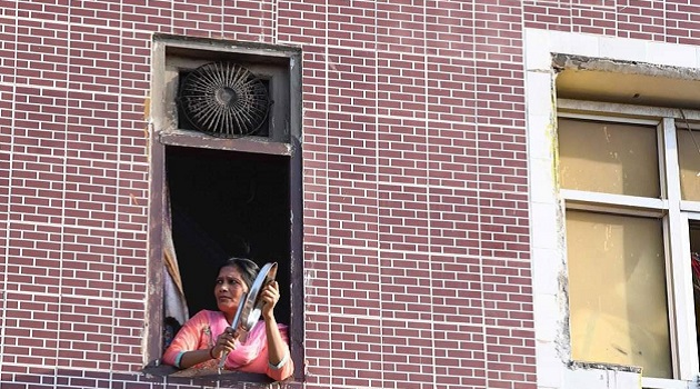 Woman banging steel utencils during Janta Curfew on March 22, 2020 in solidarity with the fight against Coronavirus