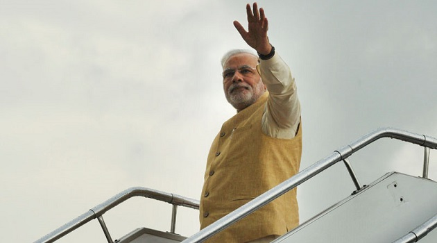 Those Were The Days: Prime Minister Narendra Modi waving to the dignitaries, on his departure from Nepal to Delhi, on August 4, 2014.